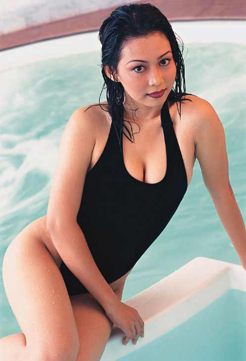 a young Indonesian woman in a black bikini