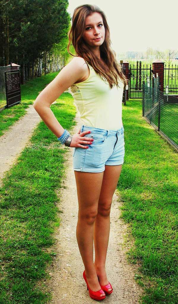a beautiful slim Hungarian girl in summer outfit in the street