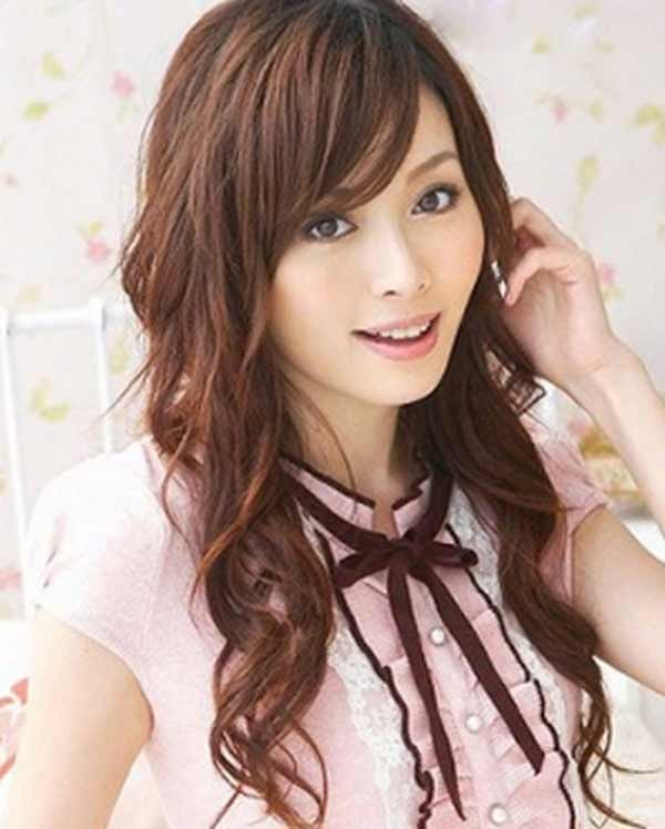 a very cute Japanese girl with long curly hair