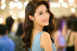 a beautiful Vietnamese girl with curly hair in a light blue dress