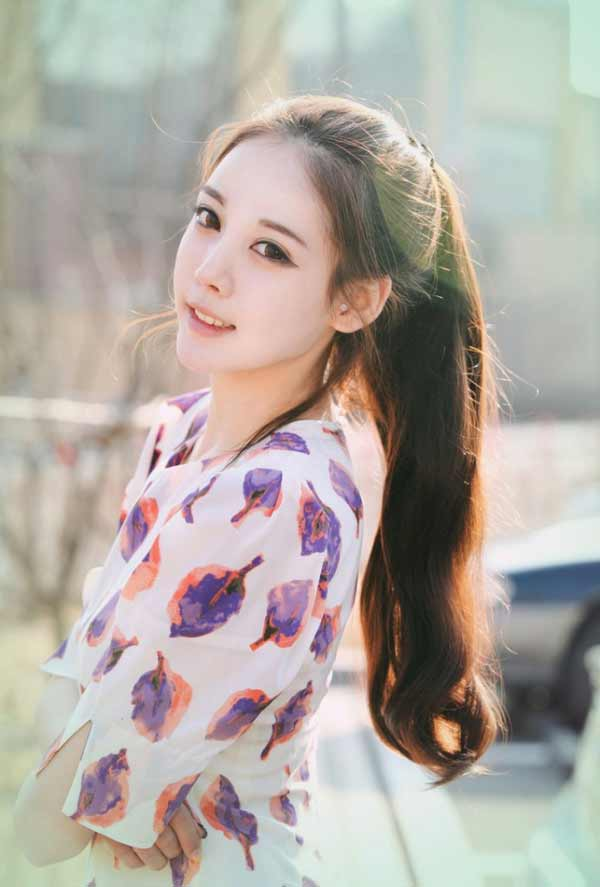 a beautiful Korean girl with pony tail