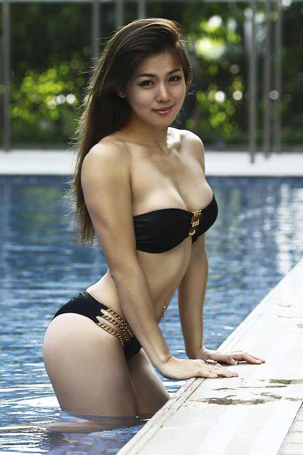 a hot Singapore girl in a provocative black bikini
