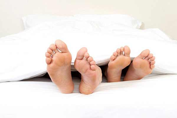 a couple of feet in bed