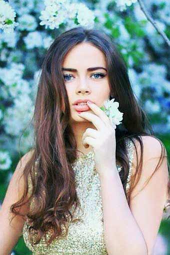 a beautiful young Russian woman with flowers in her hand