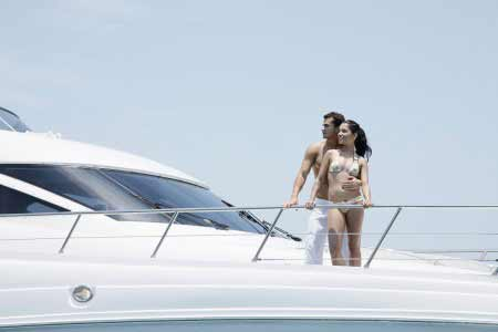 wealthy couple having rest on their yacht