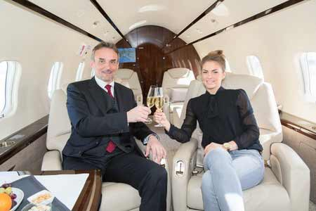 couple on board of a private plane
