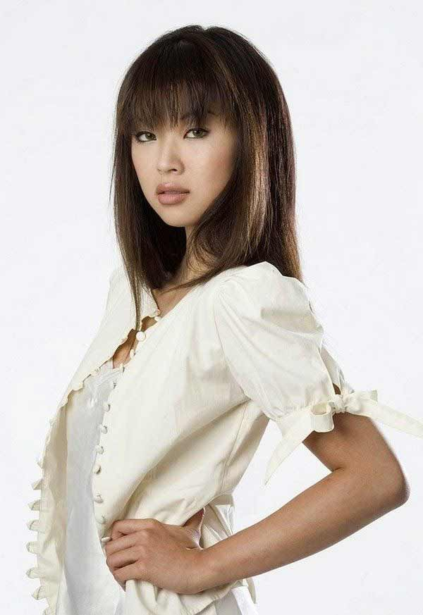 A beautiful Asian woman in white