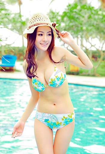 a beautiful curvy Chinese girl in a swimming suit