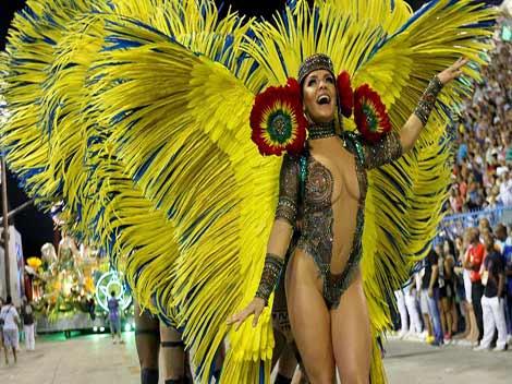 A reveller of the Mocidade samba school performs during the carnival parade at the Sambadrome in Rio de Janeiro