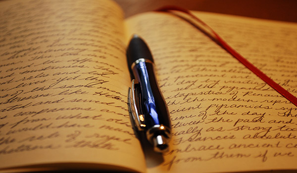 an open journal with the pen