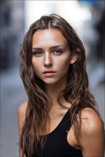 a beautiful Serbian girl with wavy hair