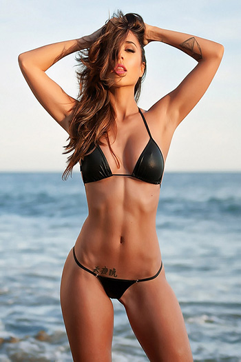 a hot Dominican woman in a black bikini