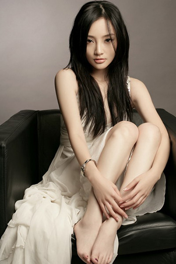 a very beautiful young Chinese woman in ivory dress