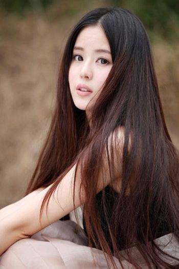 a stunning young Chinese woman with long dark brown hair