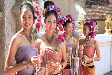 young thai women in traditional outfits