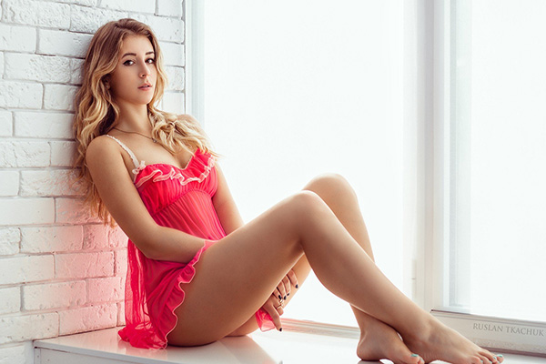 A hot blonde girl in a pink underwear