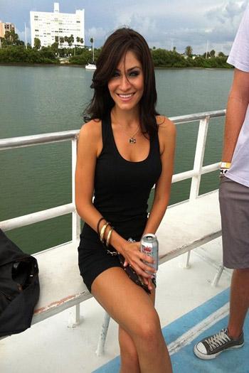 a beautiful brunette in a black dress
