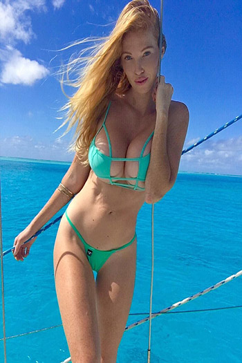 a hot red haired girl on a boat