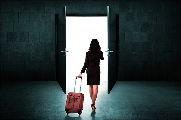 a lady leaving with a suitcase