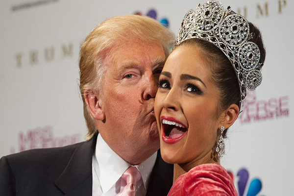 Donald Trump kissing a model on stage