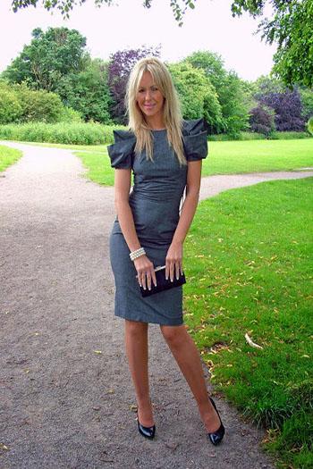 a blonde sugar momma in a grey dress