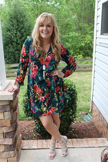a blonde sugar momma in a bright floral dress