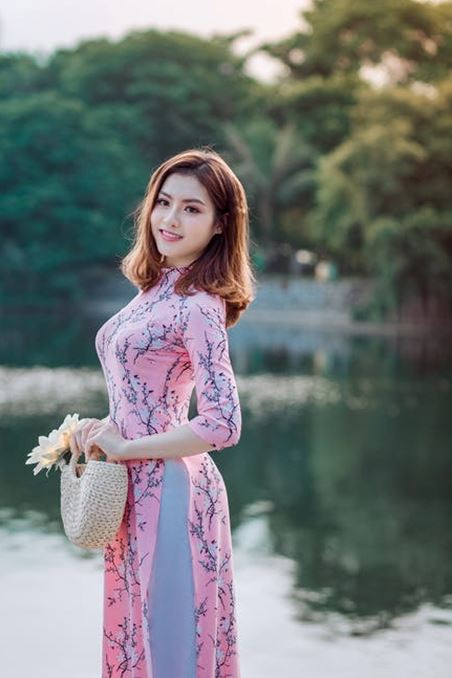 Asian lady in a pink dress